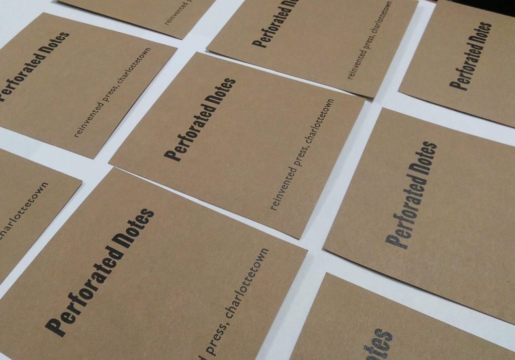 Photo of Perforated Notes covers freshly printed and waiting to dry
