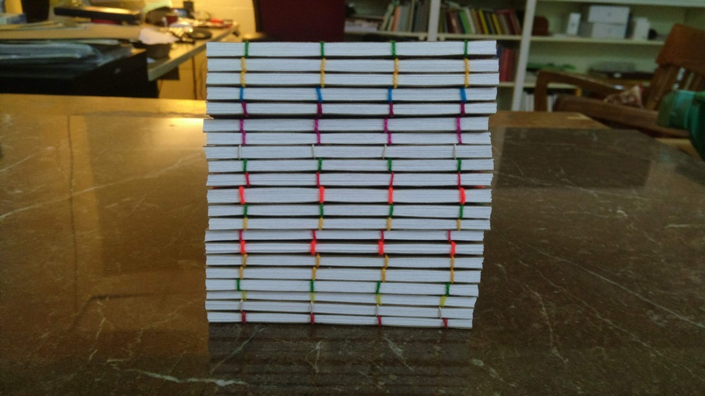 Photo of a pile of 20 Perforated Notes notebooks