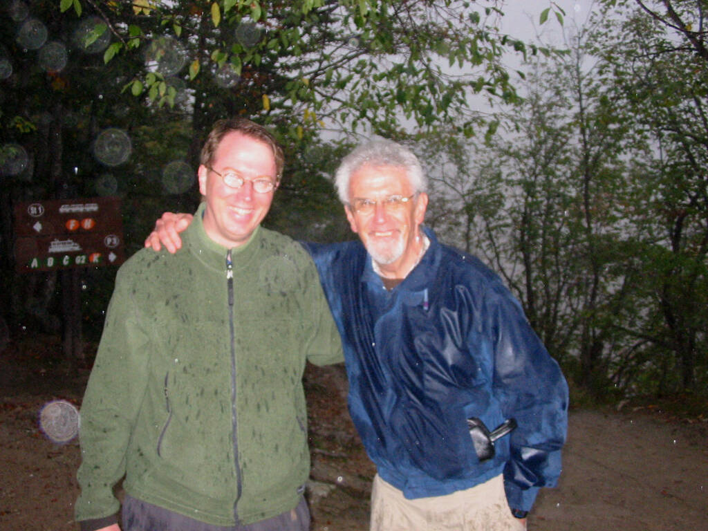 Me on the left, my father on the right, soaked from the rain, in a forest in Croatia, with our glasses fogged up.