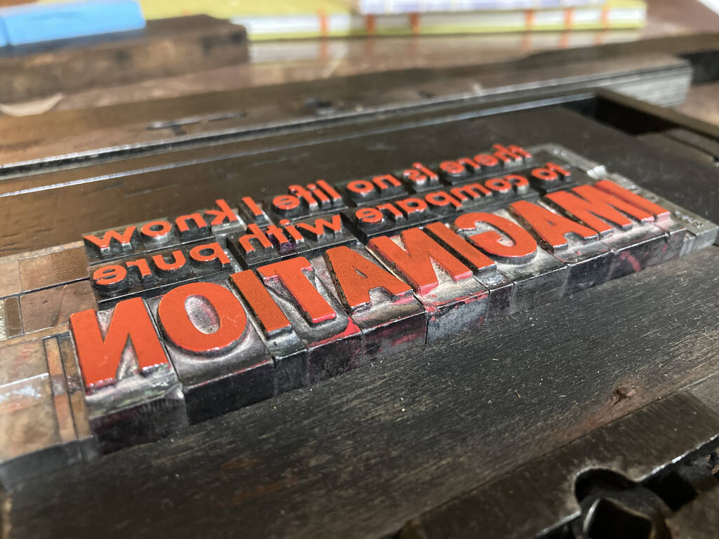 "Metal type set with line from ""Pure Imagination"" from Willy Wonka and the Chocolate Factory"
