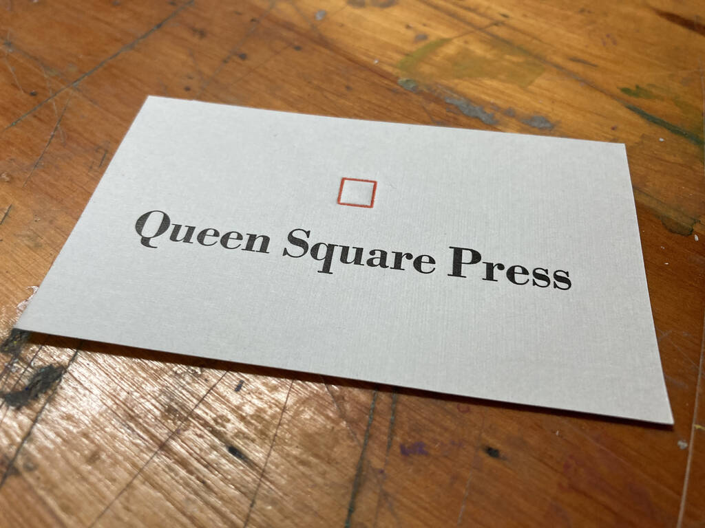 Finished Queen Square Press card, both red and black printed.