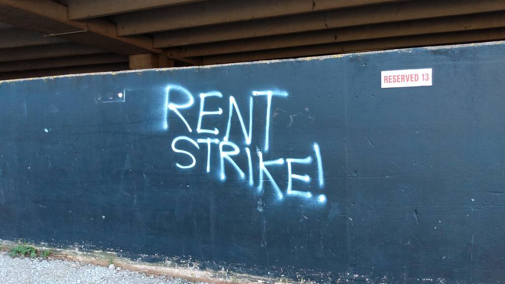Rent Strike Graffiti on the side of Queen Parkade
