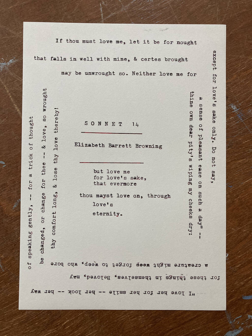 A typewritten poem, with typing in all four directions.