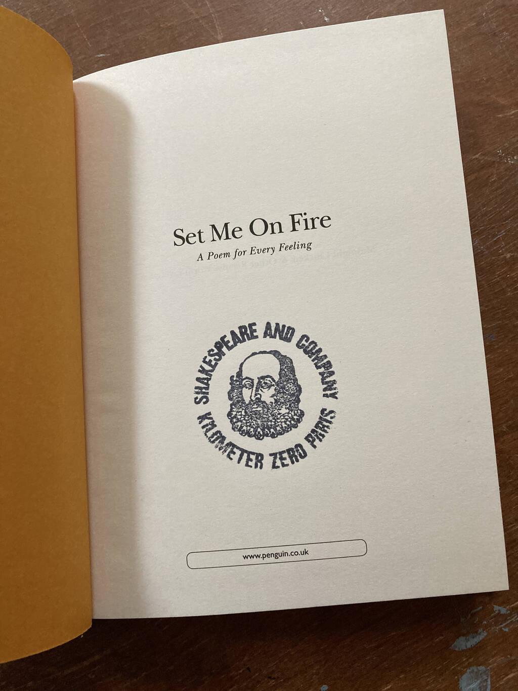 The title page of Set Me On Fire when a Shakespeare and Company rubber stamp applied.
