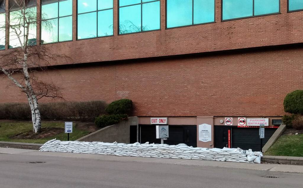 Photo of sandbags in front of the Delta Prince Edward parking garage