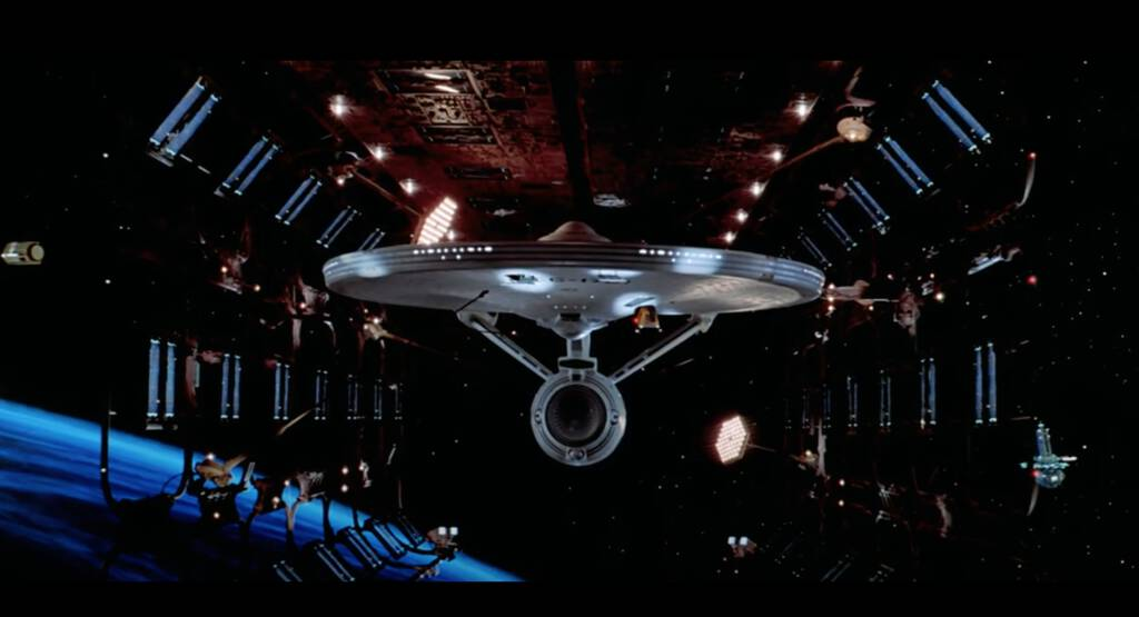 Still from Star Trek: The Motion Picture, showing the new Enterprise in dry dock from the front.