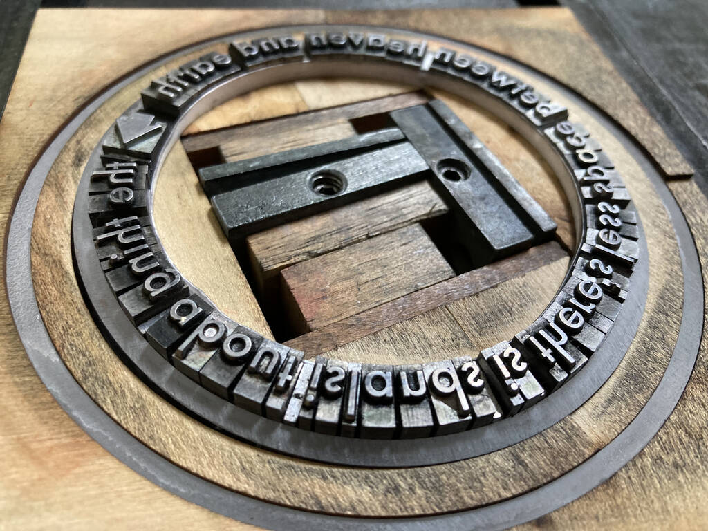 The thing about islands, in metal type...