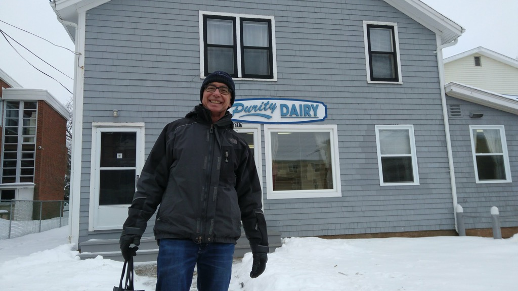 Photo of Tom Cullen in front of Purity Dairy