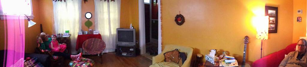 Panorama of the living room at 100 Prince, showing the TV still in the corner.