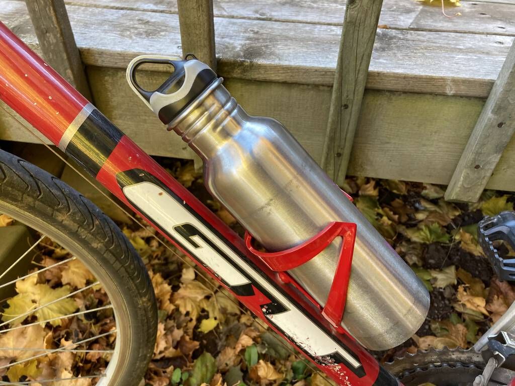 Photo of my new red water bottle rack on my bike.