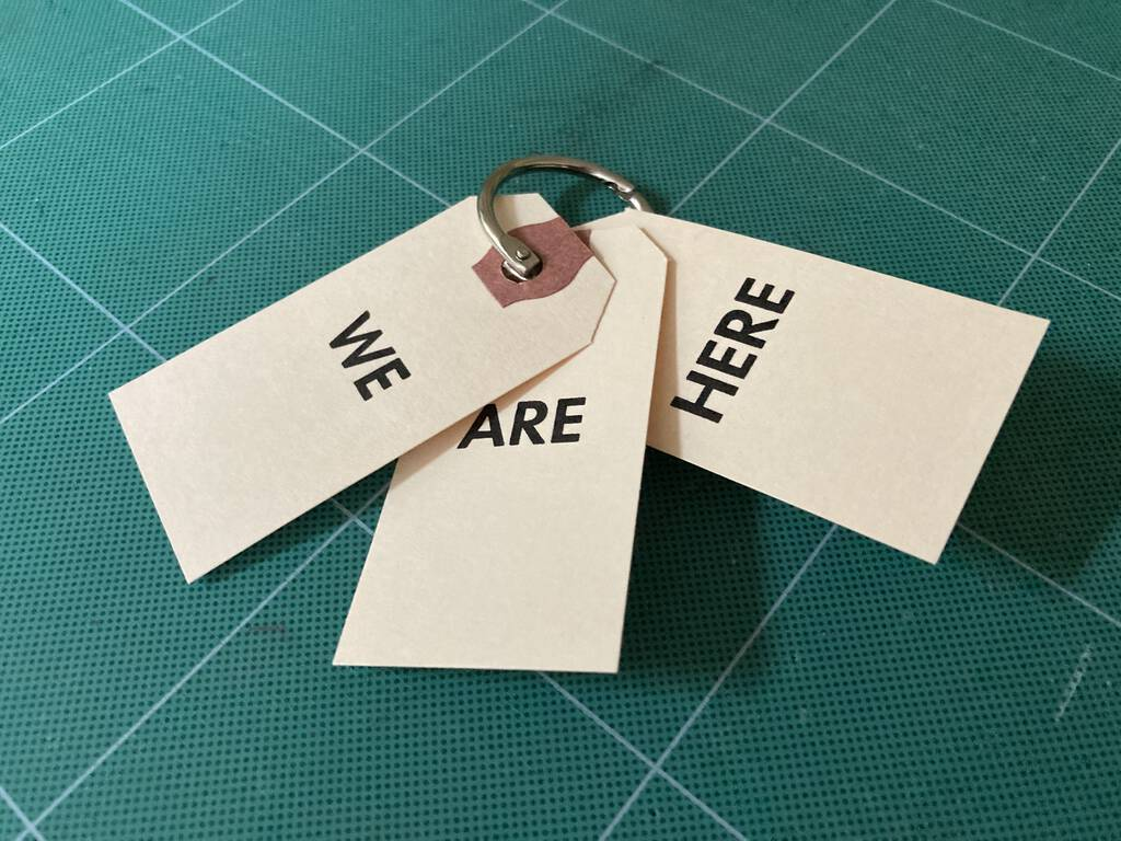We Are Here held together by a loose leaf ring.