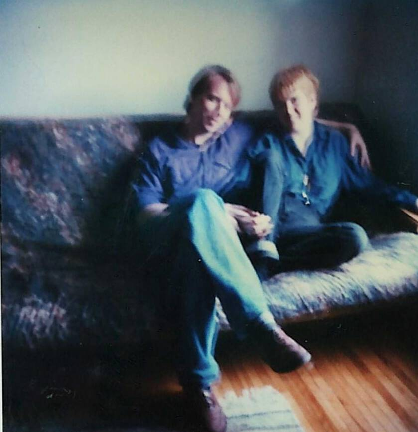Photo of me and Catherine when we were young, sitting on a futon couch.
